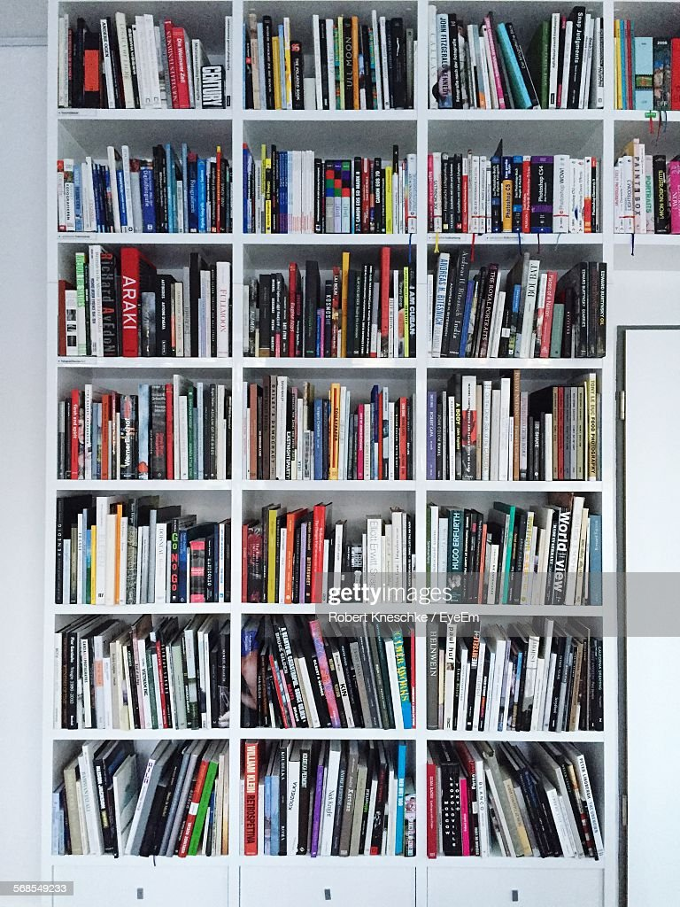 Books In Shelves At Library