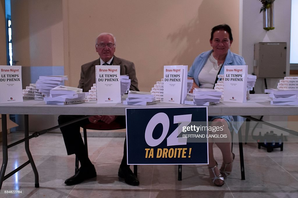 Books of French nationalist politician Bruno Megret are displayed for sale at the municipal theatre in Beziers, southern France, on May 28, 2016, during 'Le Rendez-vous de Beziers' political meeting of Beziers' mayor Robert Menard. Menard launched his own political movement 'Oz ta Droite'. / AFP / BERTRAND