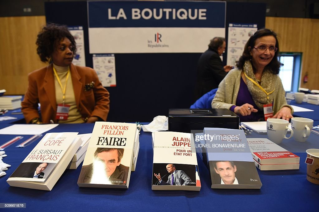 Books of French right-wing Les Republicains (LR) party members are displayed for sale at the LR National Council on February 13, 2016 in Paris. AFP PHOTO / LIONEL BONAVENTURE / AFP / LIONEL BONAVENTURE