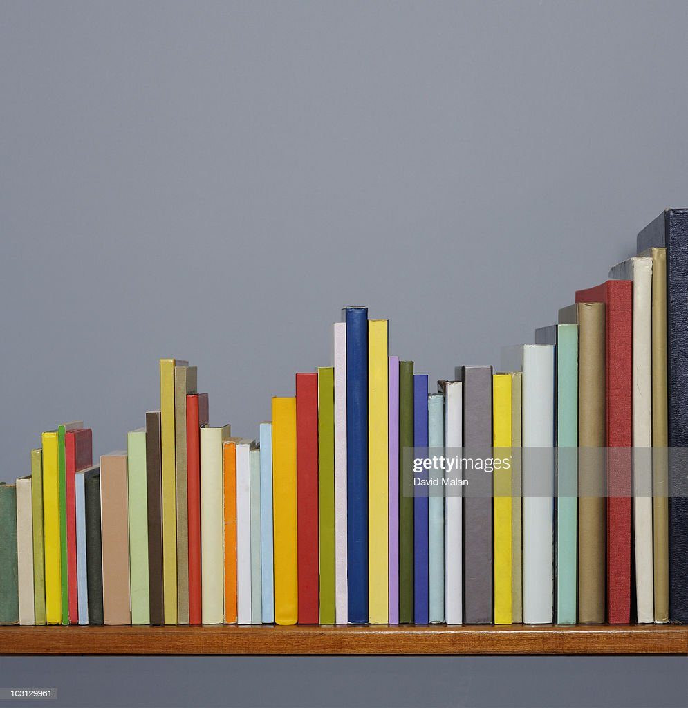 Books on a shelf forming a graph. : Stock Photo