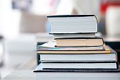 Stack of Books on a table, daylight