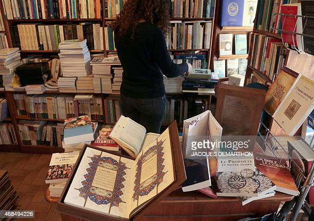 Books on Islam and interpretations of the Koran written in French are displayed at the 'Librairie de l'Orient' bookstore in Paris on March 31 2015 As...
