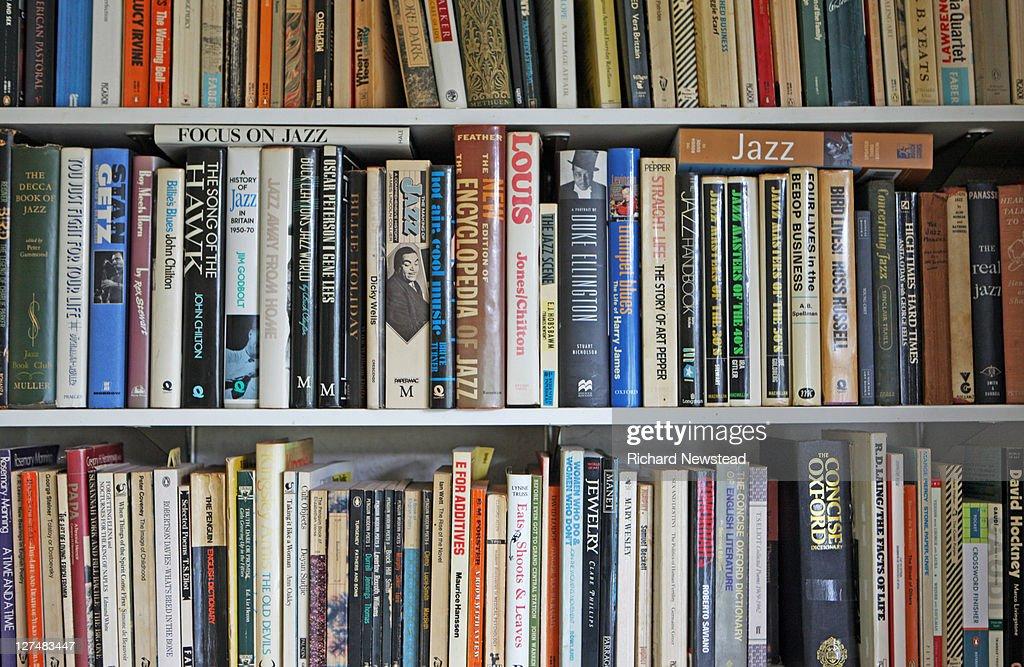 Books on shelves : Stock Photo