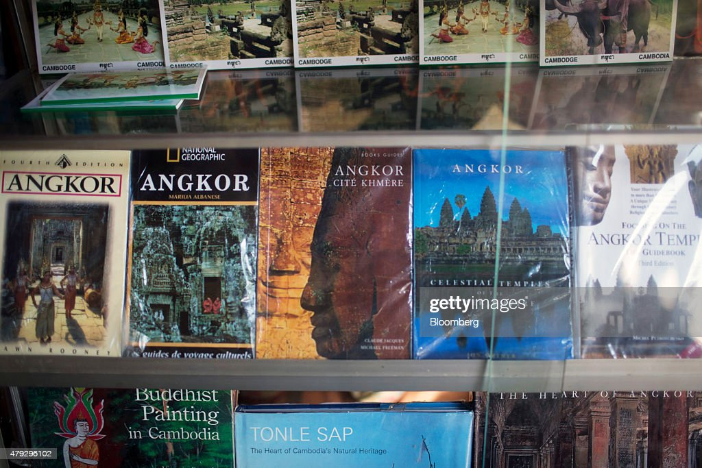 Books sit for sale at a stall near the ticket booth for the Angkor Wat temple complex in Siem Reap Cambodia on Monday June 29 2015 Angkor in the...