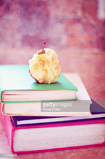 Books with eaten apple