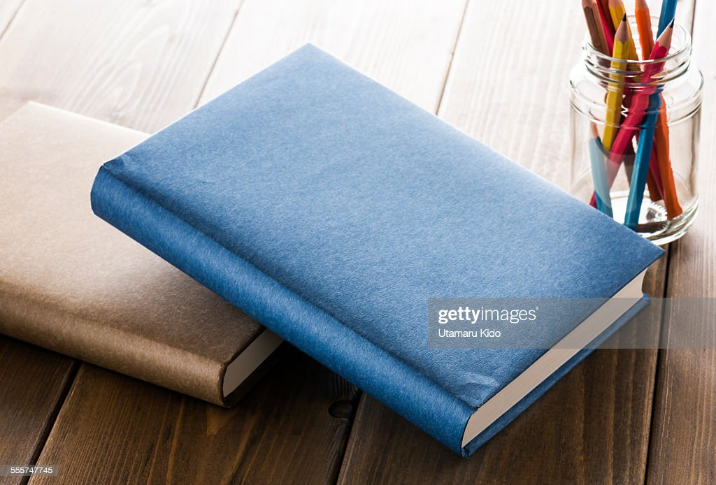 Books with office supplies.