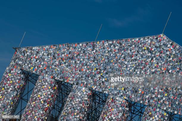 Books wrapped in plastic hang from the steel scaffolding of a construction entitled the 'Parthenon of Books' by Argentinian artist Marta Minujin on...