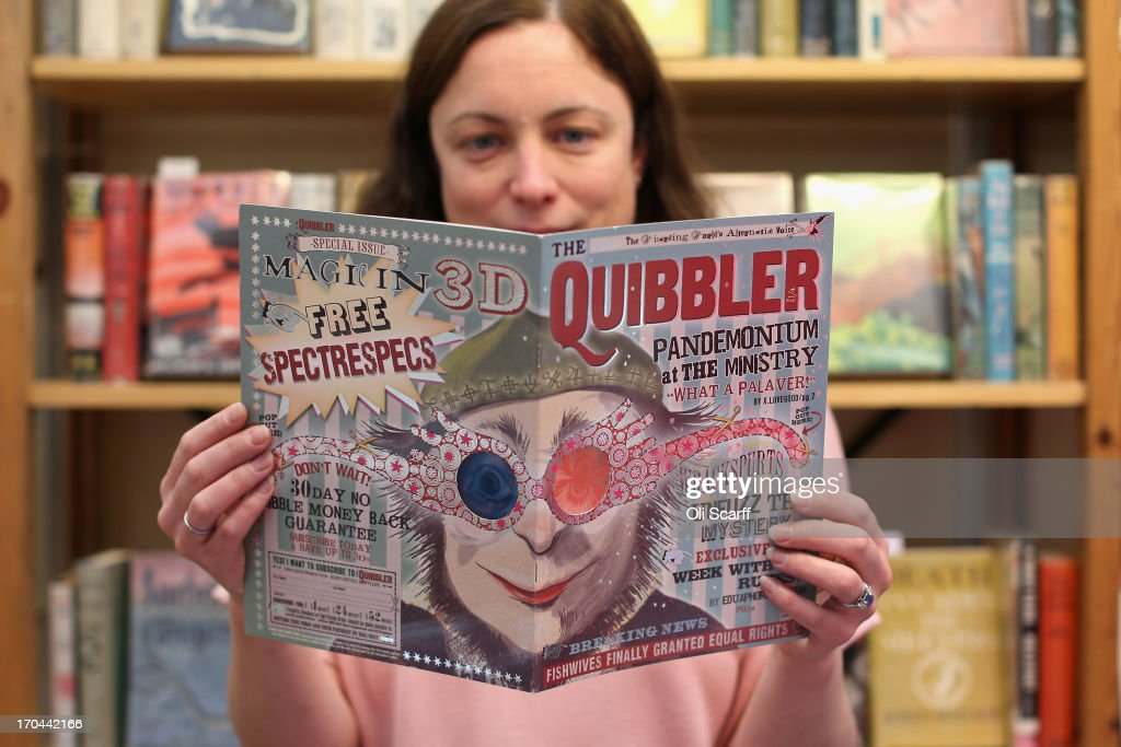 A bookseller holds a copy of 'The Quibbler', a magazine made as a prop and used in the film 'Harry Potter and the Half Blood Prince', at the London International Antiquarian Book Fair in the Olympia exhibition centre on June 13, 2013 in London, England. The Antiquarian Booksellers' Association was founded in 1906 and their book fair is the oldest in the UK having run for 56 years. It attracts approximately 200 book dealers from around the world, selling fascinating and rare books, maps, prints and manuscripts.