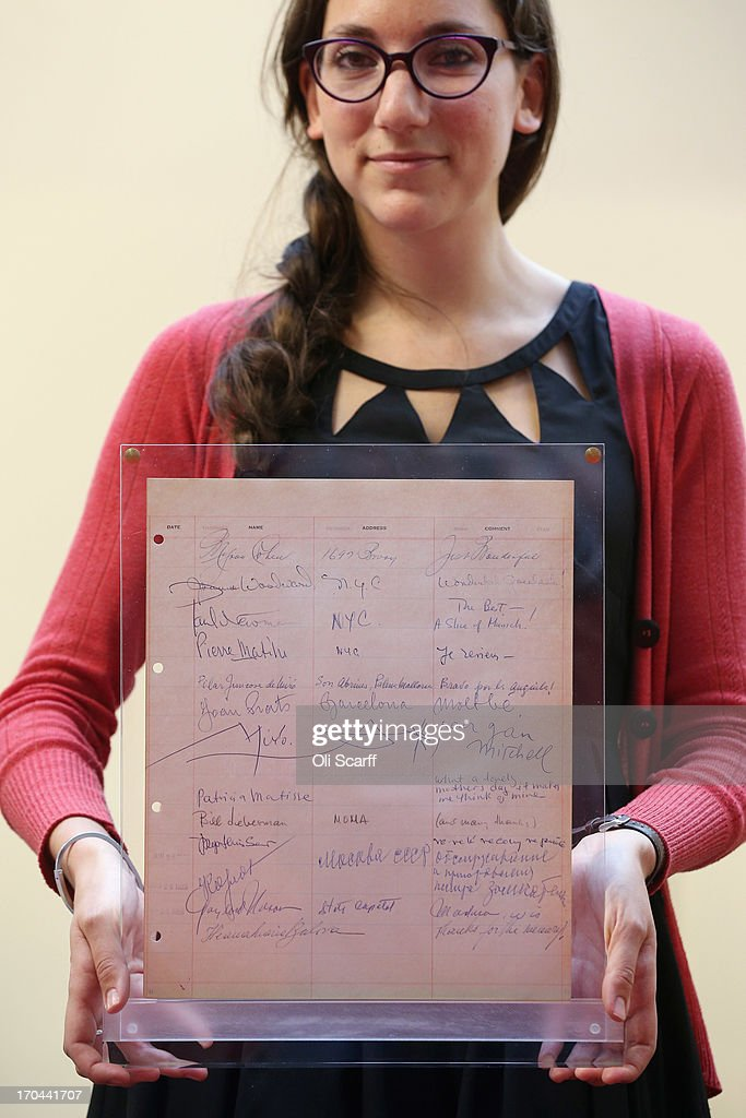 A bookseller holds a page of the guestbook from Luchows restaurant in New York, which includes the signature of Joan Miro, at the London International Antiquarian Book Fair in the Olympia exhibition centre on June 13, 2013 in London, England. The guestbook from New York's most famous German restaurant also features signatures from Alfred Hitchcock, Frank Sinatra, Elizabeth Taylor, Grace Kelly, Marlon Brando and more. The Antiquarian Booksellers' Association was founded in 1906 and their book fair is the oldest in the UK having run for 56 years. It attracts approximately 200 book dealers from around the world, selling fascinating and rare books, maps, prints and manuscripts.
