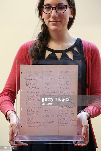 A bookseller holds a page of the guestbook from Luchows restaurant in New York which includes the signature of Joan Miro at the London International...