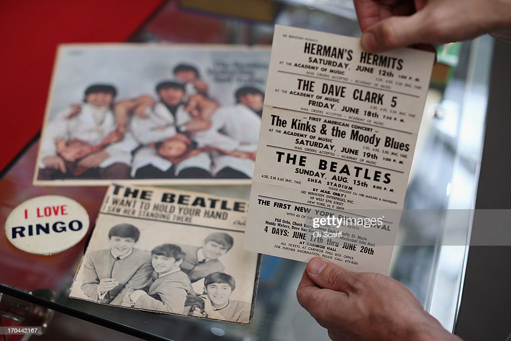 A bookseller holds Beatles ephemera formerly owned by the President of the New Jersey chapter of the Beatles Fan Club, at the London International Antiquarian Book Fair in the Olympia exhibition centre on June 13, 2013 in London, England. The Antiquarian Booksellers' Association was founded in 1906 and their book fair is the oldest in the UK having run for 56 years. It attracts approximately 200 book dealers from around the world, selling fascinating and rare books, maps, prints and manuscripts.