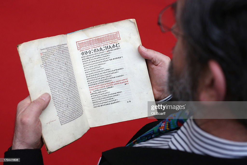 A bookseller reads a copy of the Ethiopian Psalter, a 500 year old book, of which only 24 remain and the first book printed in the Ethiopian language, at the London International Antiquarian Book Fair in the Olympia exhibition centre on June 13, 2013 in London, England. The Antiquarian Booksellers' Association was founded in 1906 and their book fair is the oldest in the UK having run for 56 years. It attracts approximately 200 book dealers from around the world, selling fascinating and rare books, maps, prints and manuscripts.