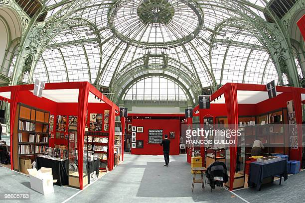 Booksellers prepare their stand on April 15 2010 at the Grand Palais in Paris on the eve of the opening of the Paris International Antiquarian Book...