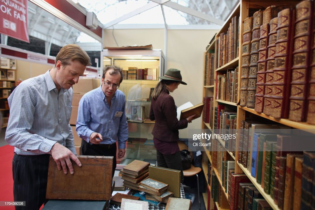 Booksellers set up their stall at the London International Antiquarian Book Fair in the Olympia exhibition centre on June 13, 2013 in London, England. The Antiquarian Booksellers' Association was founded in 1906 and their book fair is the oldest in the UK having run for 56 years. It attracts approximately 200 book dealers from around the world, selling fascinating and rare books, maps, prints and manuscripts.