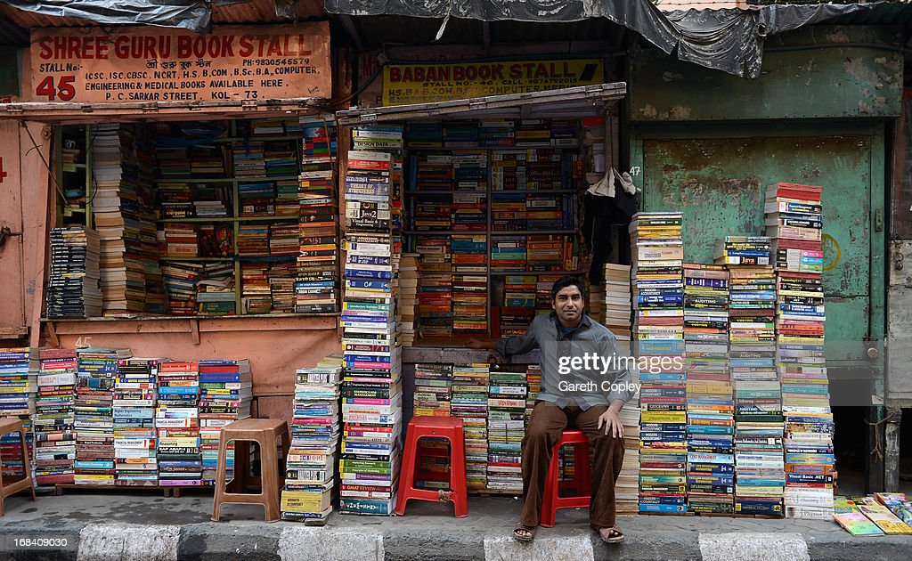 Booksellers work on their stalls on College Street on December 4, 2012 in Kolkaka, India. College Street is the largest second-hand book market in the world and largest book market in India.