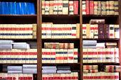 Bookshelf plenty of old legal books. Blurred background