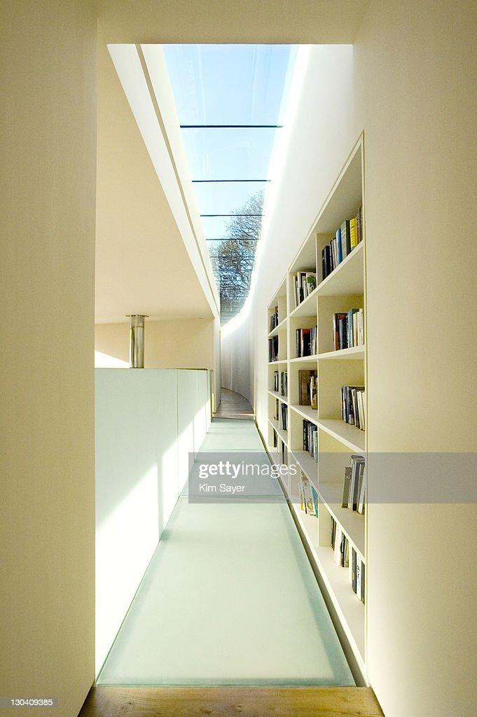 Bookshelves in hallway of modern house : Stock Photo