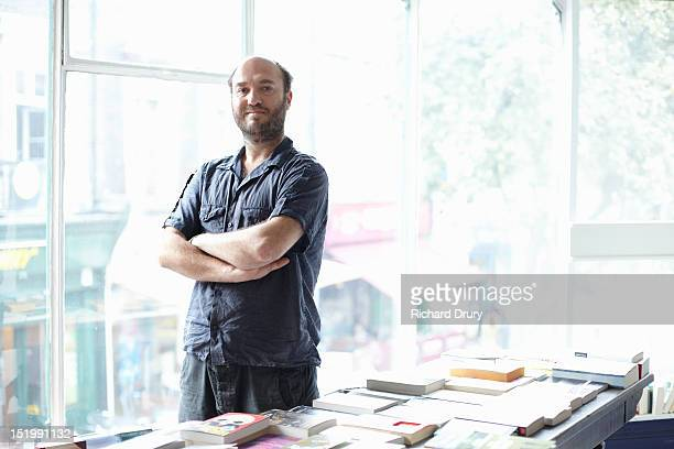 Bookshop owner in his shop