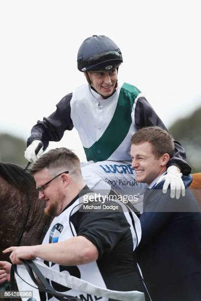 Boom Time ridden by Cory Parish celebrates with Ben Hayes after he wins the BMW Caulfield Cup during Melbourne Racing at Caulfield Racecourse on...
