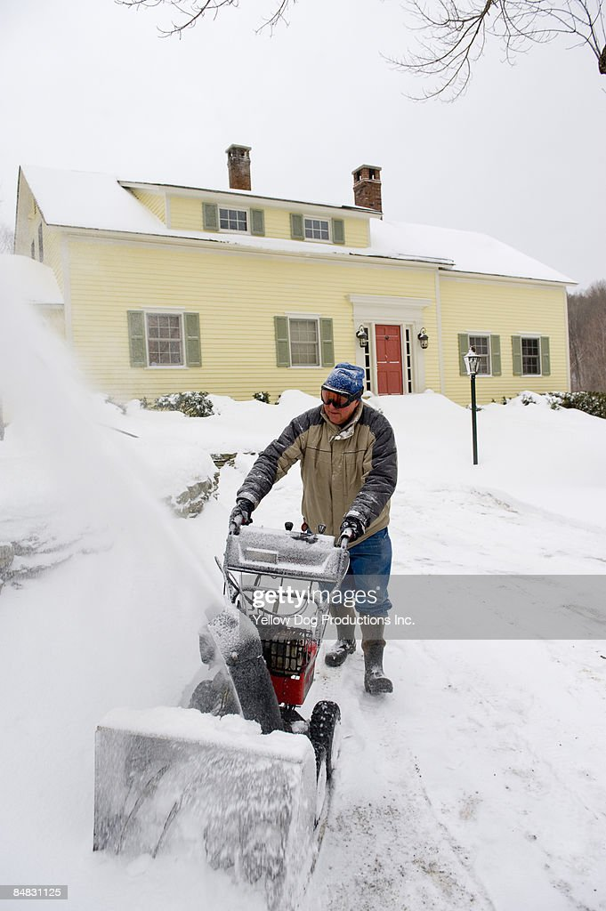 Boomer snow blowing in front of home