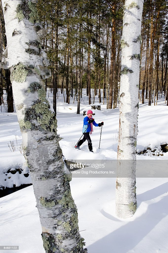 Boomer snowshoeing in the woods