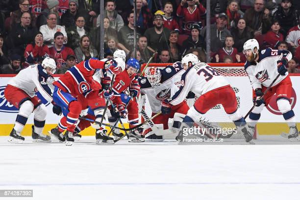 Boone Jenner Jack Johnson and Cam Atkinson of the Columbus Blue Jackets defend against the Montreal Canadiens in the NHL game at the Bell Centre on...