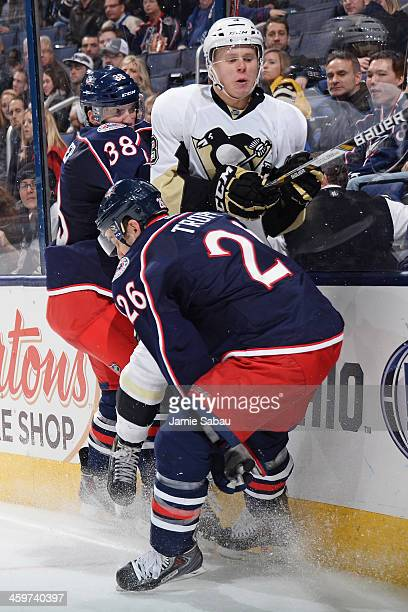 Boone Jenner of the Columbus Blue Jackets and Corey Tropp of the Columbus Blue Jackets check Olli Maatta of the Pittsburgh Penguins into the boards...