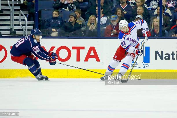 Boone Jenner of the Columbus Blue Jackets attempts to check the puck away from Kevin Shattenkirk of the New York Rangers during the game on November...