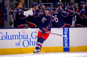 Boone Jenner of the Columbus Blue Jackets celebrates after scoring the game winning goal against the Detroit Red Wings during the third period on...