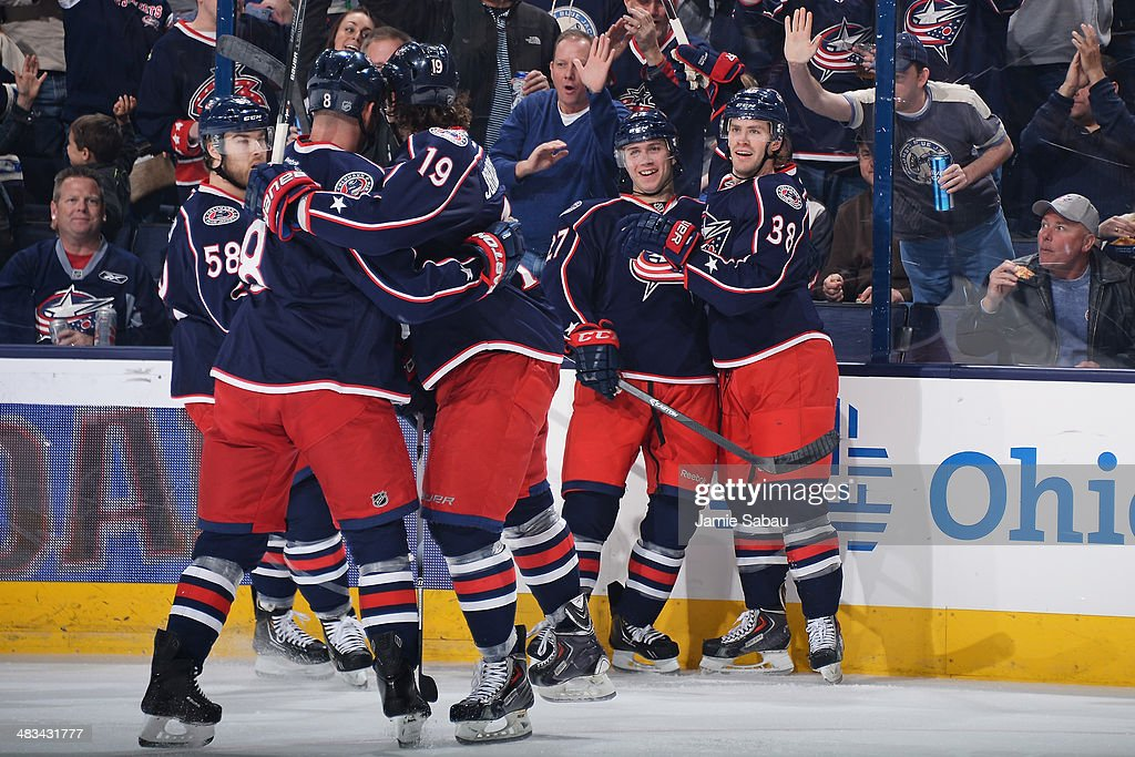 Boone Jenner #38 of the Columbus Blue Jackets celebrates his first-period goal with teammates during a game against the Phoenix Coyotes on April 8, 2014 at Nationwide Arena in Columbus, Ohio.