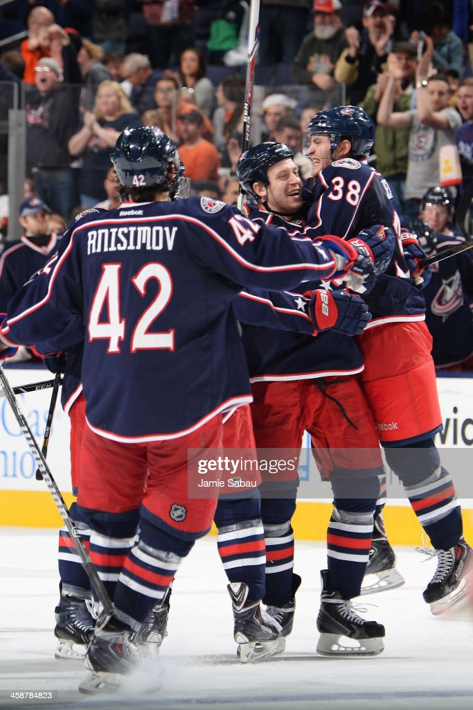 <a gi-track='captionPersonalityLinkClicked' href=/galleries/search?phrase=Boone+Jenner&family=editorial&specificpeople=6480665 ng-click='$event.stopPropagation()'>Boone Jenner</a> #38 of the Columbus Blue Jackets celebrates his third period goal with teammates <a gi-track='captionPersonalityLinkClicked' href=/galleries/search?phrase=Nikita+Nikitin&family=editorial&specificpeople=722107 ng-click='$event.stopPropagation()'>Nikita Nikitin</a> #6 of the Columbus Blue Jackets and <a gi-track='captionPersonalityLinkClicked' href=/galleries/search?phrase=Artem+Anisimov&family=editorial&specificpeople=543215 ng-click='$event.stopPropagation()'>Artem Anisimov</a> #42 of the Columbus Blue Jackets during the third period in a game against the Philadelphia Flyers on December 21, 2013 at Nationwide Arena in Columbus, Ohio. Columbus defeated Philadelphia 6-3.