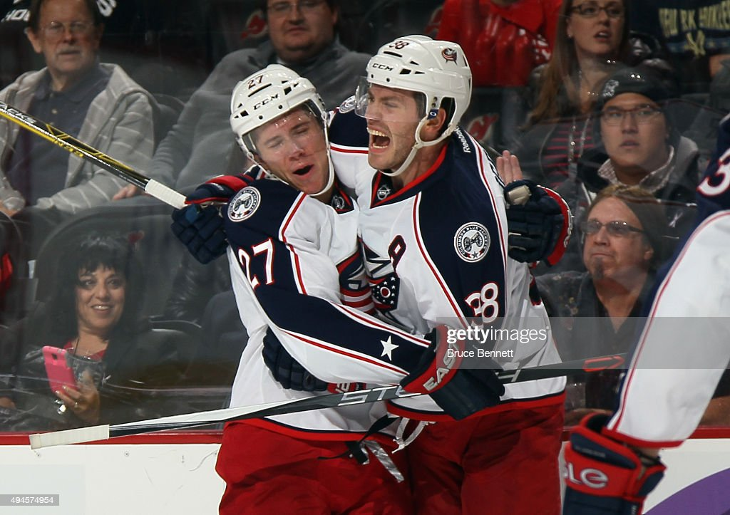 Boone Jenner of the Columbus Blue Jackets celebrates his third period goal against the New Jersey Devils along with Ryan Murray at the Prudential...
