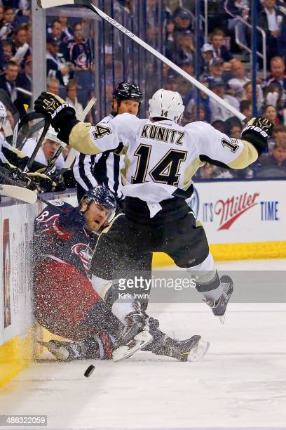 Boone Jenner of the Columbus Blue Jackets collides with Chris Kunitz of the Pittsburgh Penguins during the second period in Game Four of the First...