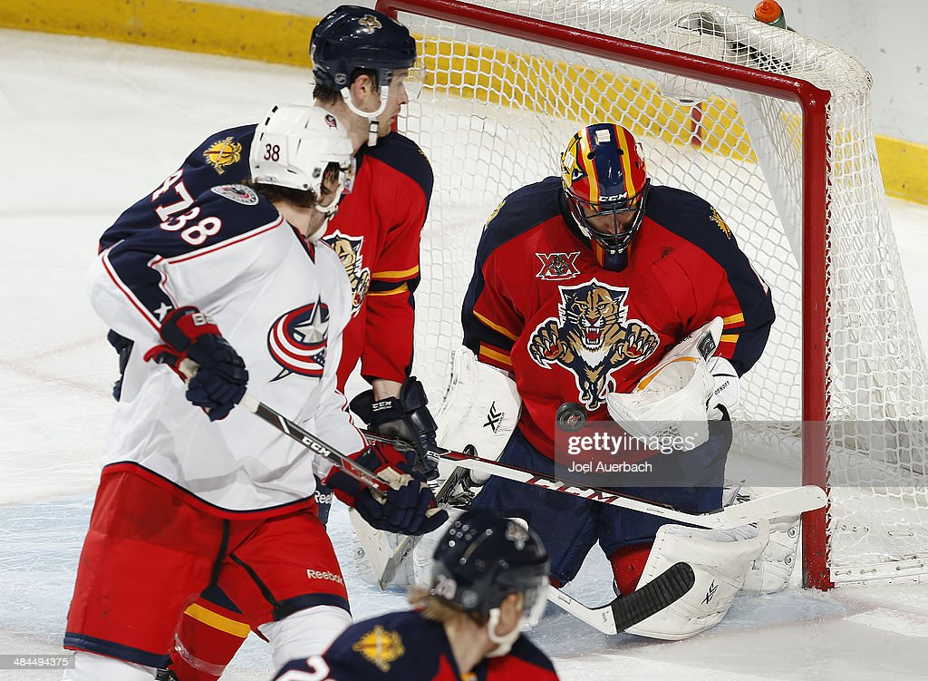 <a gi-track='captionPersonalityLinkClicked' href=/galleries/search?phrase=Boone+Jenner&family=editorial&specificpeople=6480665 ng-click='$event.stopPropagation()'>Boone Jenner</a> #38 of the Columbus Blue Jackets looks back as goaltender <a gi-track='captionPersonalityLinkClicked' href=/galleries/search?phrase=Roberto+Luongo&family=editorial&specificpeople=202638 ng-click='$event.stopPropagation()'>Roberto Luongo</a> #1 of the Florida Panthers stops a shot at the BB&T Center on April 12, 2014 in Sunrise, Florida. The Blue Jackets defeated the Panthers 3-2.