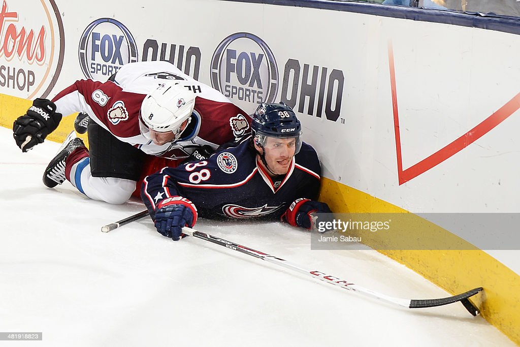<a gi-track='captionPersonalityLinkClicked' href=/galleries/search?phrase=Boone+Jenner&family=editorial&specificpeople=6480665 ng-click='$event.stopPropagation()'>Boone Jenner</a> #38 of the Columbus Blue Jackets reaches for the puck after being knocked to the ice by <a gi-track='captionPersonalityLinkClicked' href=/galleries/search?phrase=Jan+Hejda&family=editorial&specificpeople=624333 ng-click='$event.stopPropagation()'>Jan Hejda</a> #8 of the Colorado Avalanche during the third period on April 1, 2014 at Nationwide Arena in Columbus, Ohio. Colorado defeated Columbus 3-2 in overtime.