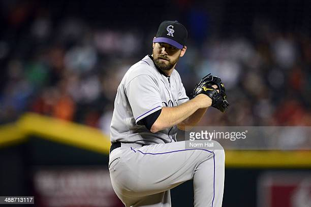 Boone Logan of the Colorado Rockies delivers a pitch against the Arizona Diamondbacks at Chase Field on April 28 2014 in Phoenix Arizona