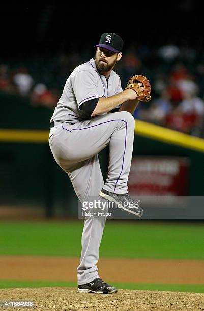 Boone Logan of the Colorado Rockies delivers a pitch against the Arizona Diamondbacks during the eighth inning of a MLB game at Chase Field on April...