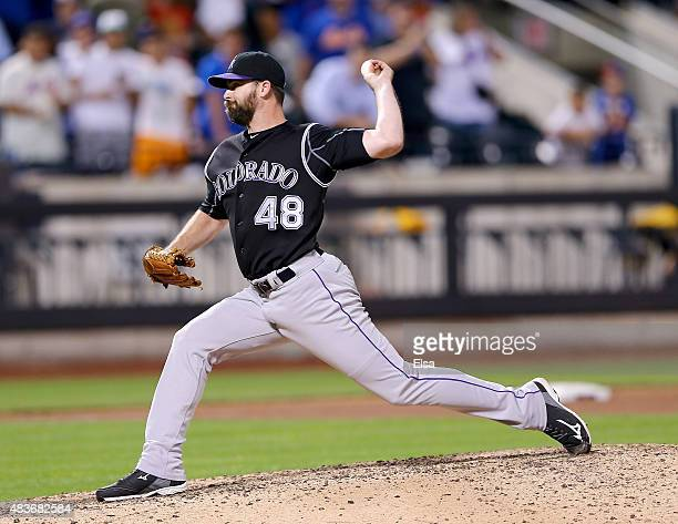 Boone Logan of the Colorado Rockies delivers a pitch in the eighth inning against the New York Mets on August 11 2015 at Citi Field in the Flushing...