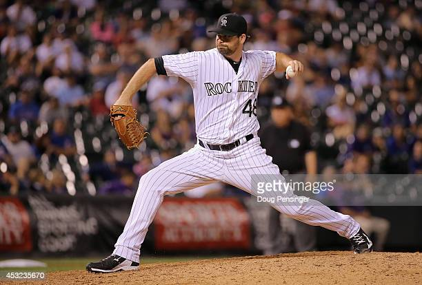 Boone Logan of the Colorado Rockies delivers against the Chicago Cubs as he collected the loss when the Cubs defeated the Rockies 65 in 12 innings at...