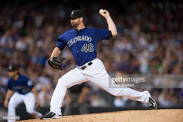 Boone Logan of the Colorado Rockies pitches against the Arizona Diamondbacks in the seventh inning of a game at Coors Field on June 4 2014 in Denver...