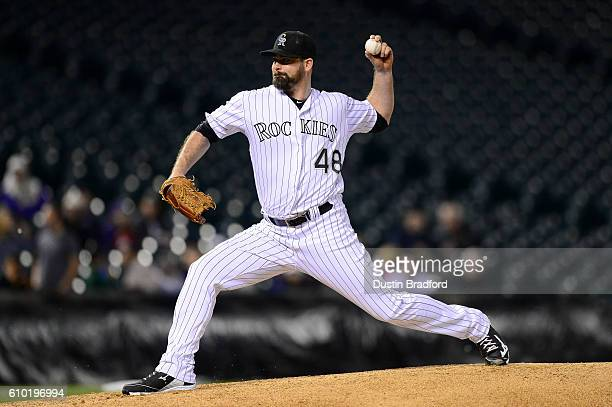 Boone Logan of the Colorado Rockies pitches against the San Diego Padres in the ninth inning of a game at Coors Field on September 16 2016 in Denver...