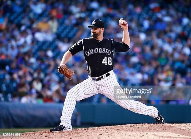 Boone Logan of the Colorado Rockies pitches during a regular season MLB game between the Colorado Rockies and the visiting San Diego Padres at Coors...