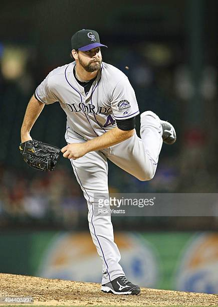 Boone Logan of the Colorado Rockies throws in the ninth inning against the Texas Rangers at Globe Life Park in Arlington on May 7 2014 in Arlington...