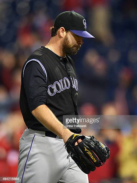 Boone Logan of the Colorado Rockies walks off the mound after giving up a home run to the Philadelphia Phillies in the ninth inning at Citizens Bank...