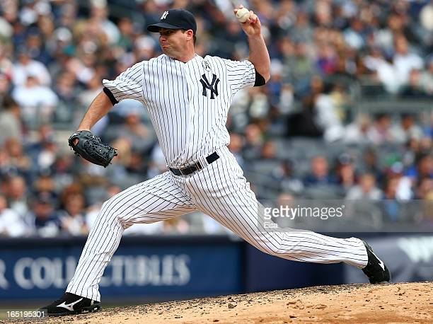 Boone Logan of the New York Yankees delivers a pitch against the Boston Red Sox during Opening Day on April 1 2013 at Yankee Stadium in the Bronx...