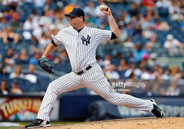Boone Logan of the New York Yankees in action against the Los Angeles Angels of Anaheim at Yankee Stadium on August 15 2013 in the Bronx borough of...