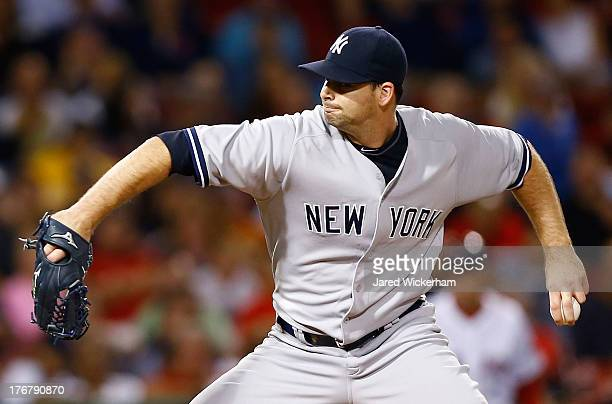 Boone Logan of the New York Yankees pitches against the Boston Red Sox during the game on August 18 2013 at Fenway Park in Boston Massachusetts