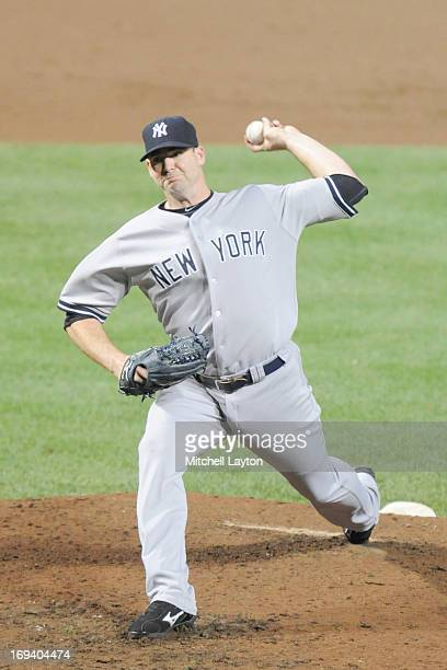 Boone Logan of the New York Yankees pitches during a baseball game against the Baltimore Orioles on May 20 2013 at Oriole Park at Camden Yards in...