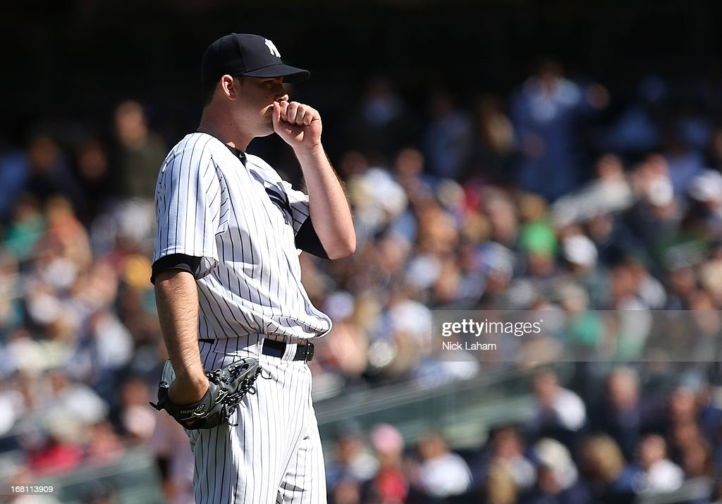 Boone Logan #48 of the New York Yankees reacts after giving up a solo home run in the eighth inning against the Oakland Athletics at Yankee Stadium on May 5, 2013 in the Bronx borough of New York City.