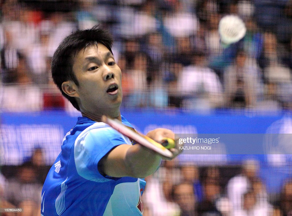 Boonsak Ponsana of Thailand returns the shot against Lee Chong Wei of Malaysia during their men's singles final at the Japan Open badminton tournament in Tokyo on September 23, 2012. Lee Chong Wei won the match 21-18, 21-18.